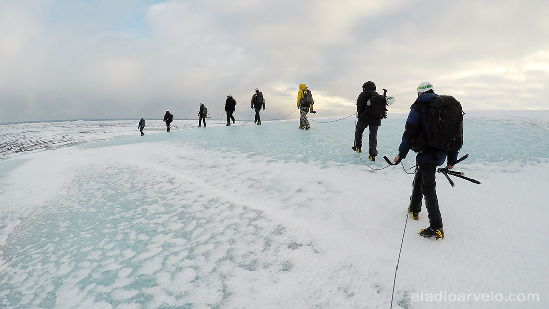 Hiking on glacier during ice cave excursion.