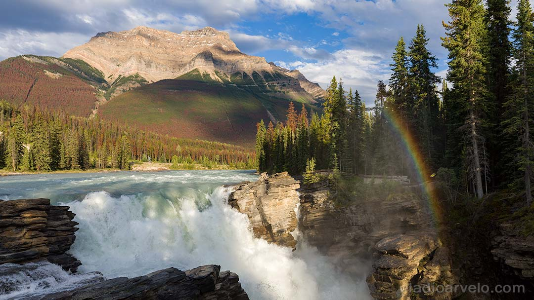Rainbow in the mist of Athabasca Falls at Jasper National Park.