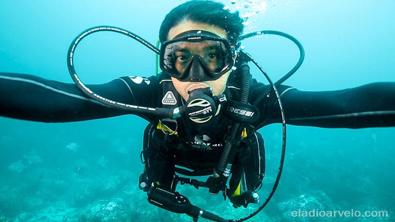 Eladio scuba diving.