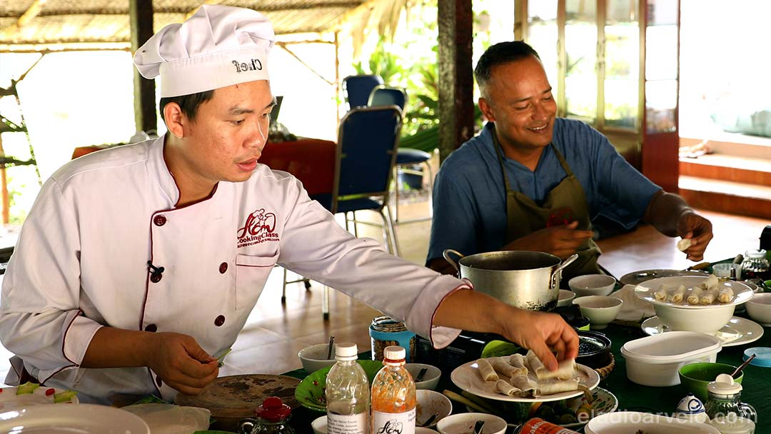Chef Tan teaching Vietnamese cuisine to Shareef in Ho Chi Minh City.