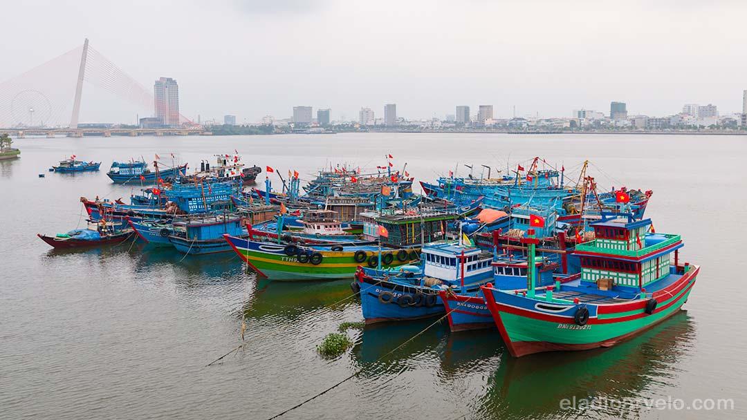 Colorful fishing boats anchored together in Da Nang.