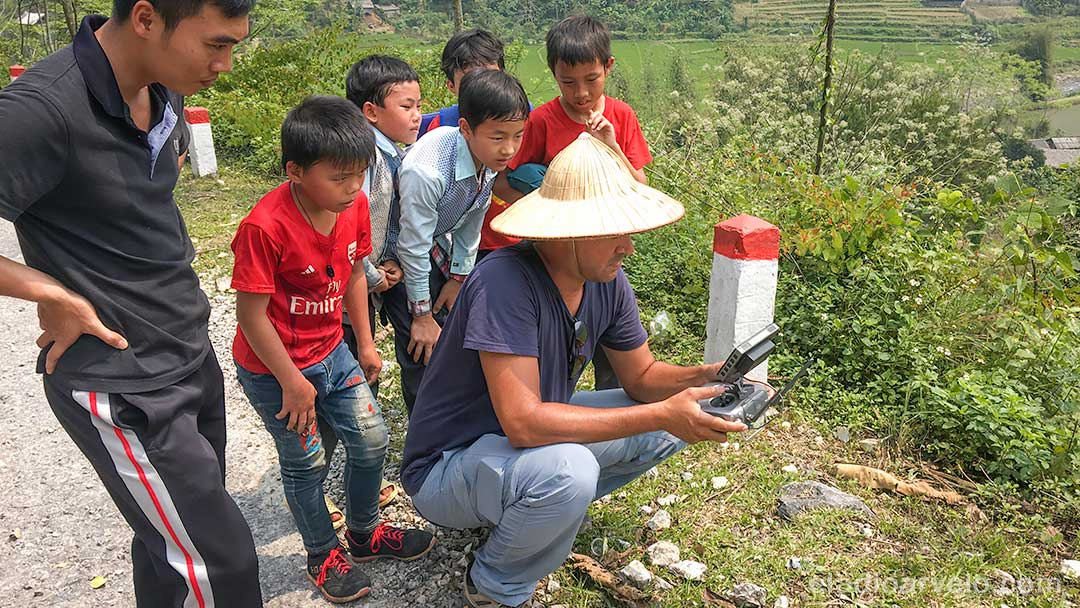 Eladio piloting his drone with an audience in Ha Giang. (Photo credit: Shareef Haq).