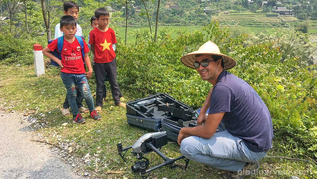 Eladio preparing to fly his drone with an audience in Ha Giang. (Photo credit: Shareef Haq).