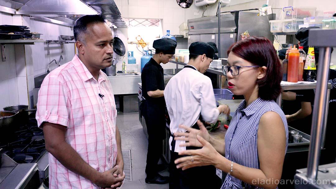 Huong Dang describing KOTO to Shareef Haq in Hanoi.